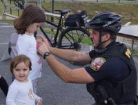 Bike officer with kids at Safety Fair